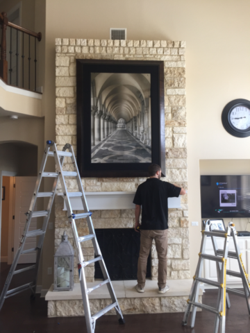 Art Installed on Stone Fireplace